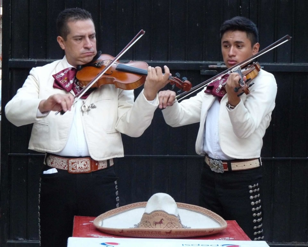 Mariachi musicians donning traditional charro suits
