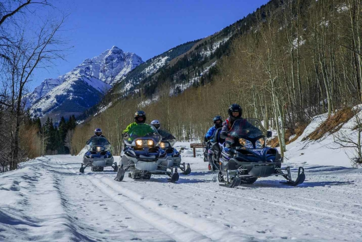 Go on a guided snowmobile in Aspen, Colorado, with T-Lazy-7 Ranch