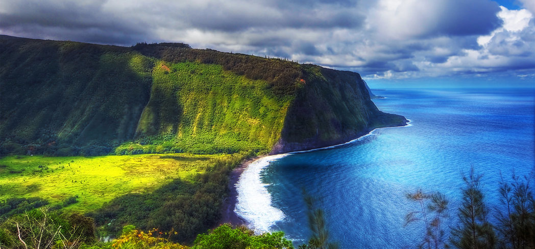 Explore the sights of the Waipio Valley on an ATV tour, one of GAYOT's Top 10 Things to Do on the Big Island of Hawaii