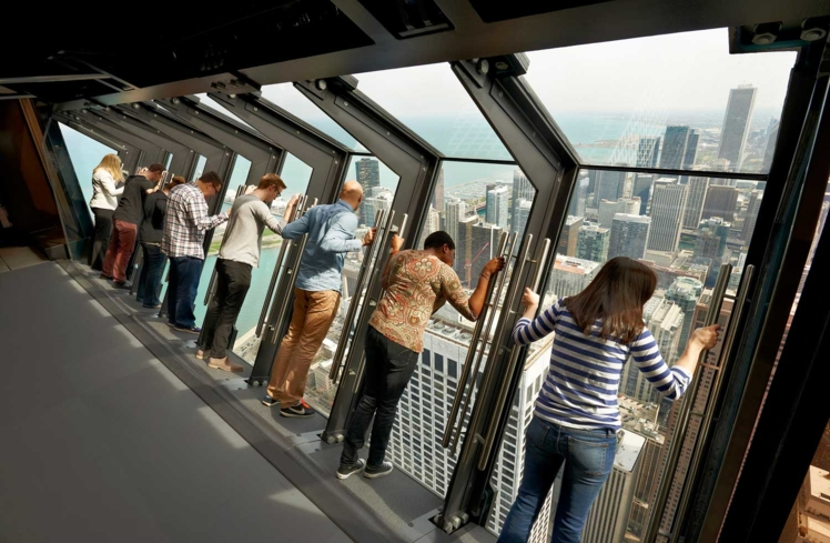 A view of guests on TILT, 360 CHICAGO's thrilling attraction