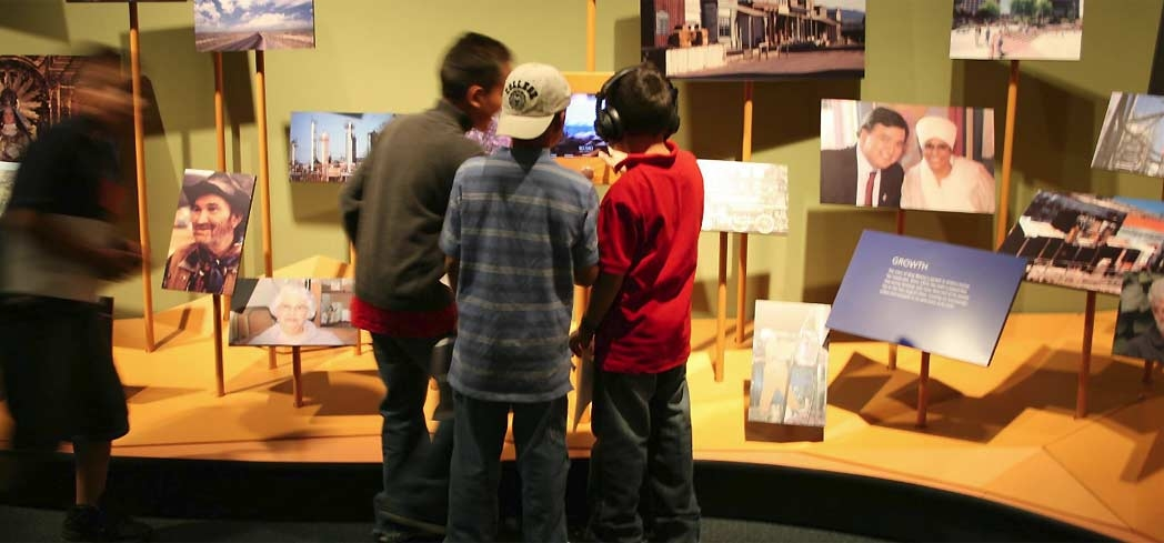 Children view an exhibit at the New Mexico History Museum