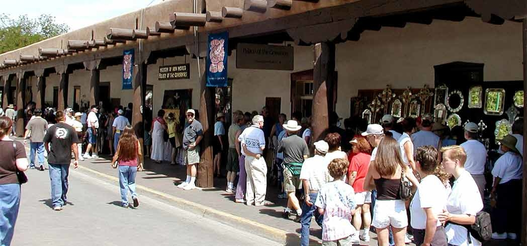 People gathered for the market outside of the Palace of the Governors in Santa Fe, New Mexico