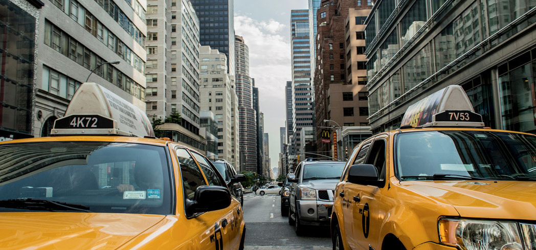Iconic taxi cabs and high rise buildings in New York City