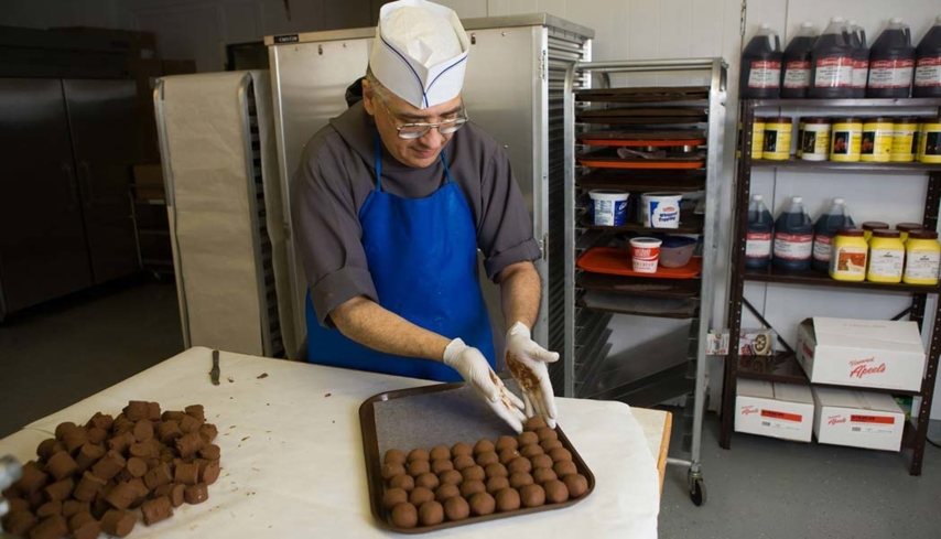 A Brigittine monk making truffles