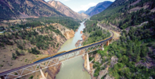 The Rocky Mountaineer crossing the Canyon Bridge over the Fraser River near Lillooet