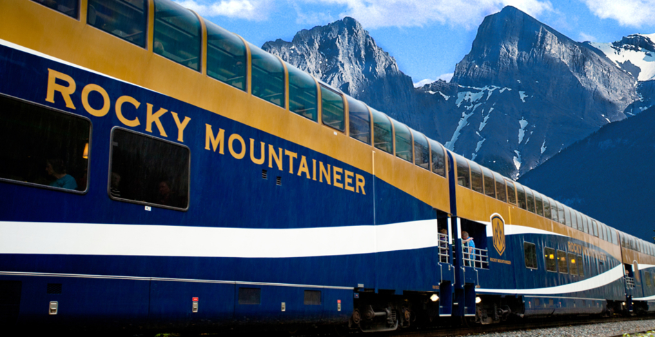 The GoldLeaf coach in front of the Rocky Mountains