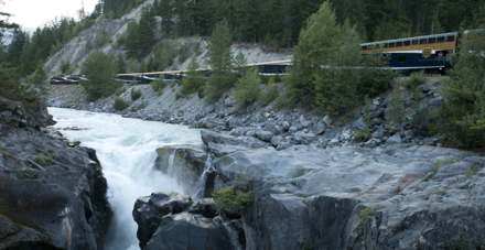 Train travelling by Nairn Falls, BC