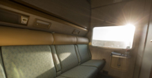 The Gold Service cabin's twin bed during the day