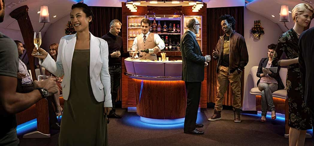 Guests can stretch their legs and have a drink at the Business Class Lounge aboard select Emirates airliners