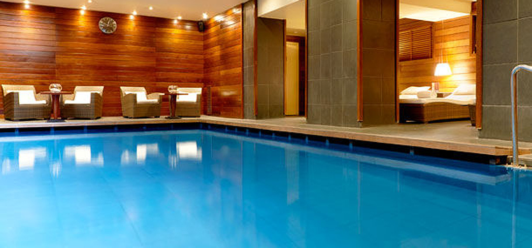 The indoor pool bathed in natural light at The Vendôme SPA by Asian Villa inside the Renaissance Paris Vendôme Hotel.