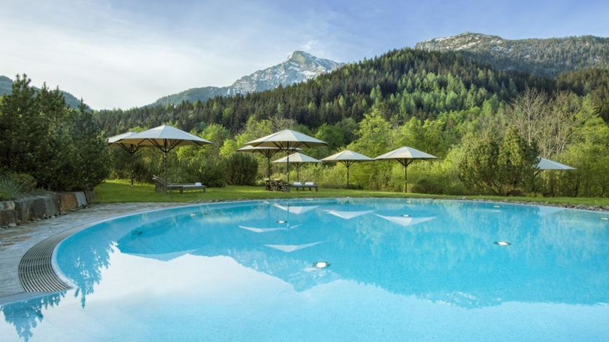 The outdoor pool with a scenic view at Kempinski The Spa
