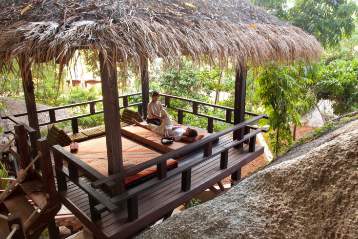 An outdoor massage at Anantara Rasananda Spa