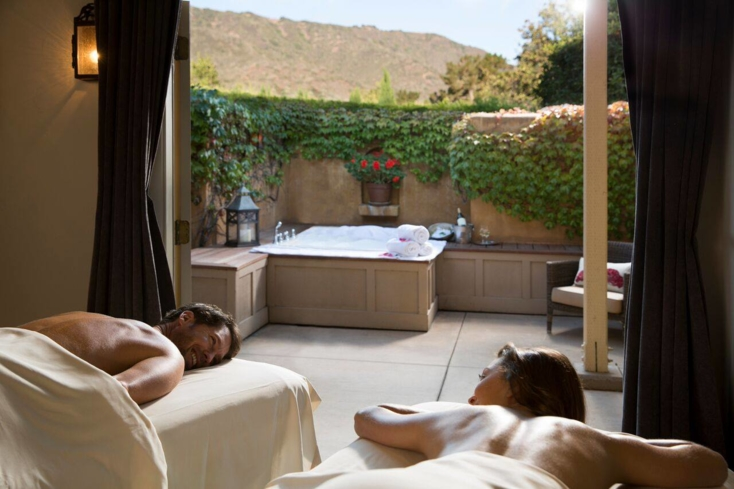 A couple enjoys a treatment at The Spa at Bernardus Lodge