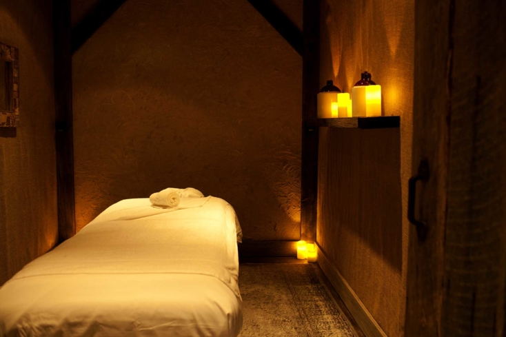 The Moonshine Spa's treatment rooms are done in neutral, earthy tones at this underground getaway inside Le Parker Meridien