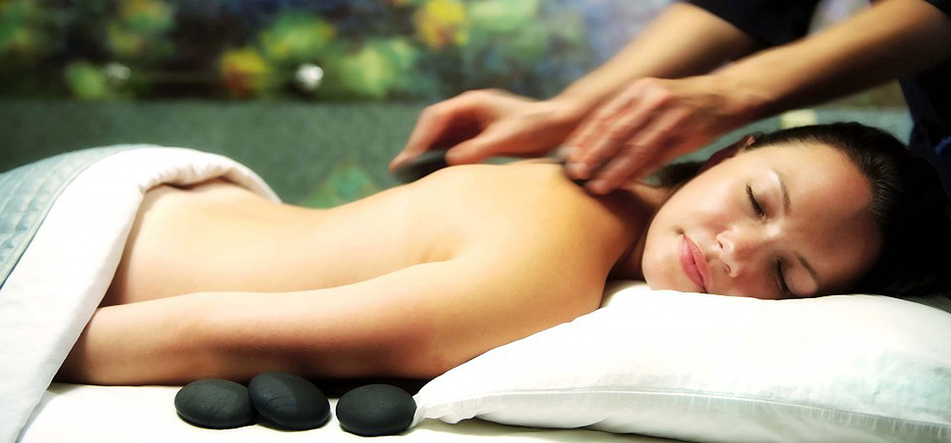 A hot stone massage at Spa Mirbeau