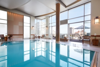 Enjoy breathtaking views of the city in The Nob Hill Spa's infinity pool