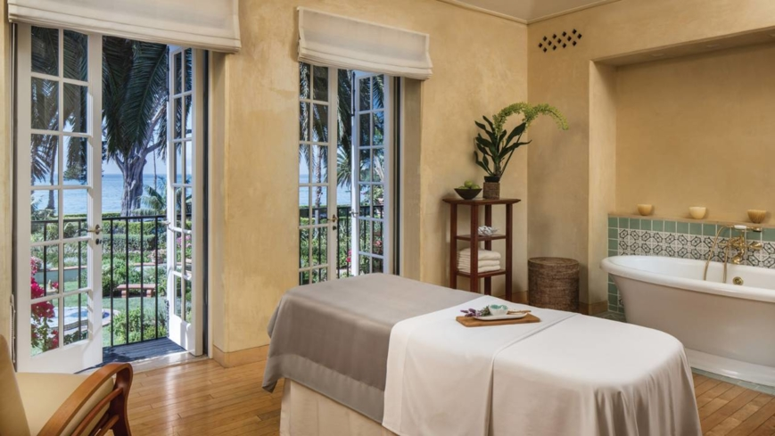 A treatment room with an ocean view at The Spa at Four Seasons Resort, The Biltmore