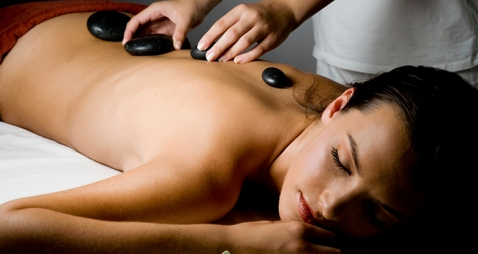 A hot stone massage at V Spa at the Hilton Anatole