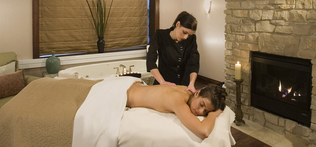 A massage at Aspira Spa inside The Osthoff Resort
